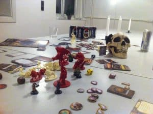 Descent: Journeys in the Dark ministures and skull on table