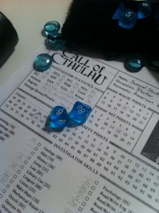 Call of Cthulhu character sheet and blue dice