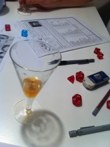 Call of Cthulhu character sheet and drink