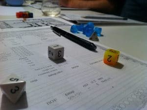 The Savage World of Solomon Kane character sheet and dice